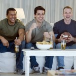 100267630-3-guys-watching-football-gettyp.240x160